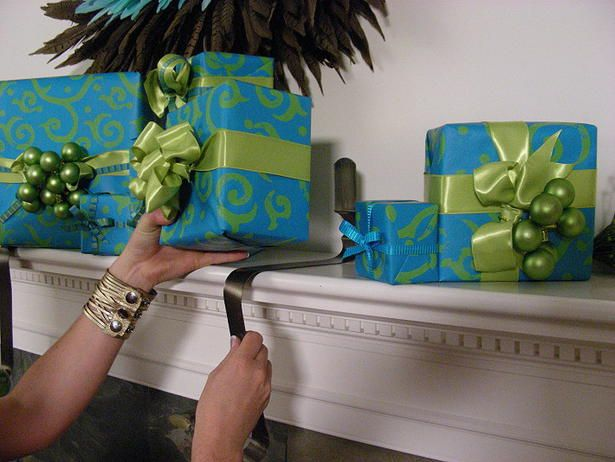 How to make stocking holder from wreath hanger.    http://www.hgtv.com/holidays-occasions/wrapped-gift-stocking-holders/index.html