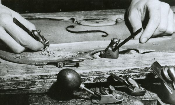 This photograph from the 1940s shows the hands of violin maker Kitty Smith (1912-2005) shaping a violin with a tiny plane.