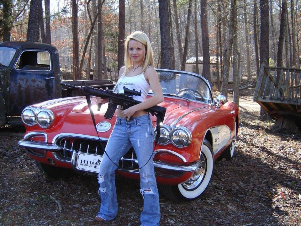 Pretty girl, 58 Corvette, classic Chevy truck & a nice AR type rifle...NICE!