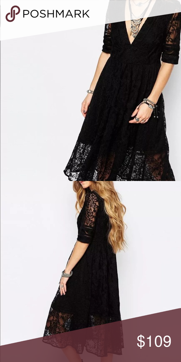 "Free People Mountain Laurel lace midi dress A Romantic Elbow-Sleeve V-Neck Empire Midi Dress Accented With Sheer Panels  Of Floral Lace Channels A Bohemian-Inspired Spin On A Prim and Polished Victorian  Afternoon Tea Dress;  Fully Lined; Pull-Over Style            Material Shell 75% Cotton / 25% Nylon.                         Lining Rayon.  Retail: $168  Color   Black  Size :  0  -  Approx. 41.5"" length from shoulder, armpit to armpit approx. 16"" Free People Dresses Midi"