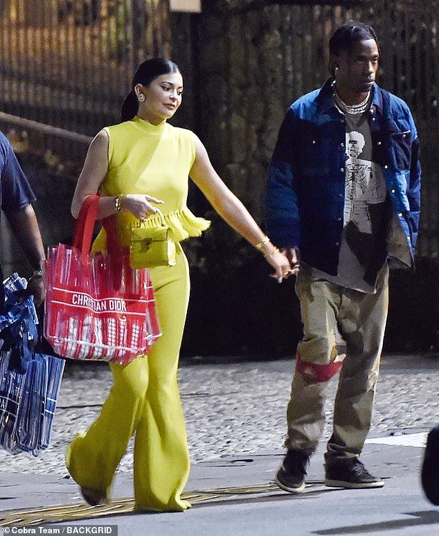 Kylie Jenner dazzles in yellow as she holds hands with
