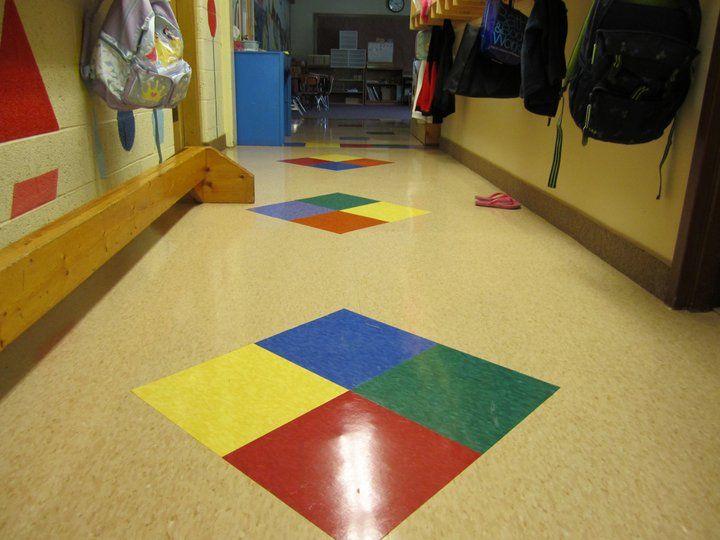 Commercial Vct Vinyl Composite Tile In A Daycare Tile Patterns Vct Tile Showroom Interior Design