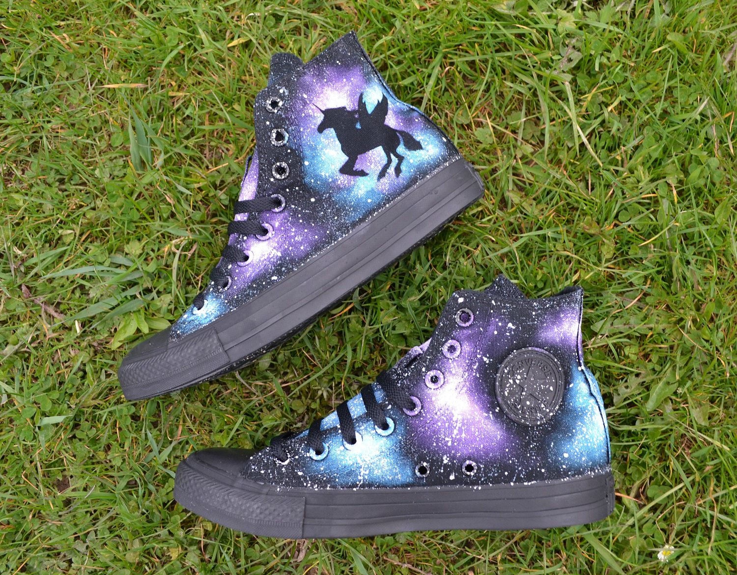Galaxy Converse with a quirky unicorn silhouette. I always use genuine Converse and hours of love and attention go into each pair, meaning you can be certain to receive something really special. Im open to any customisations, just ask! :)  The unicorn is one ONE side - the outside of the shoe. The inside, which has the Converse badge, is painted in a galaxy design, as shown in the photos.  Check out my shop for all my other shoe designs!   *SIZING* Listed in both UK and EUR sizes. See the…