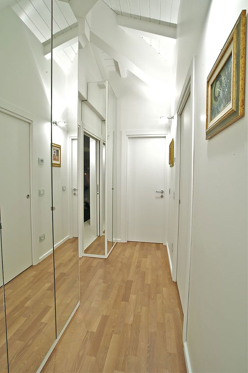 Interior delicate penthouse designs with classic and sleek white theme inspiring mirrored hallway design ideas at attic penthouses with shades of white