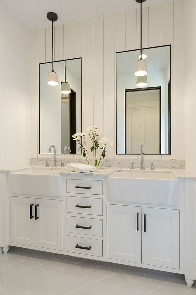 Bathroom Mirrors Farmhouse bathroom shiplap wall behind mirrors. bathroom with shiplap wall