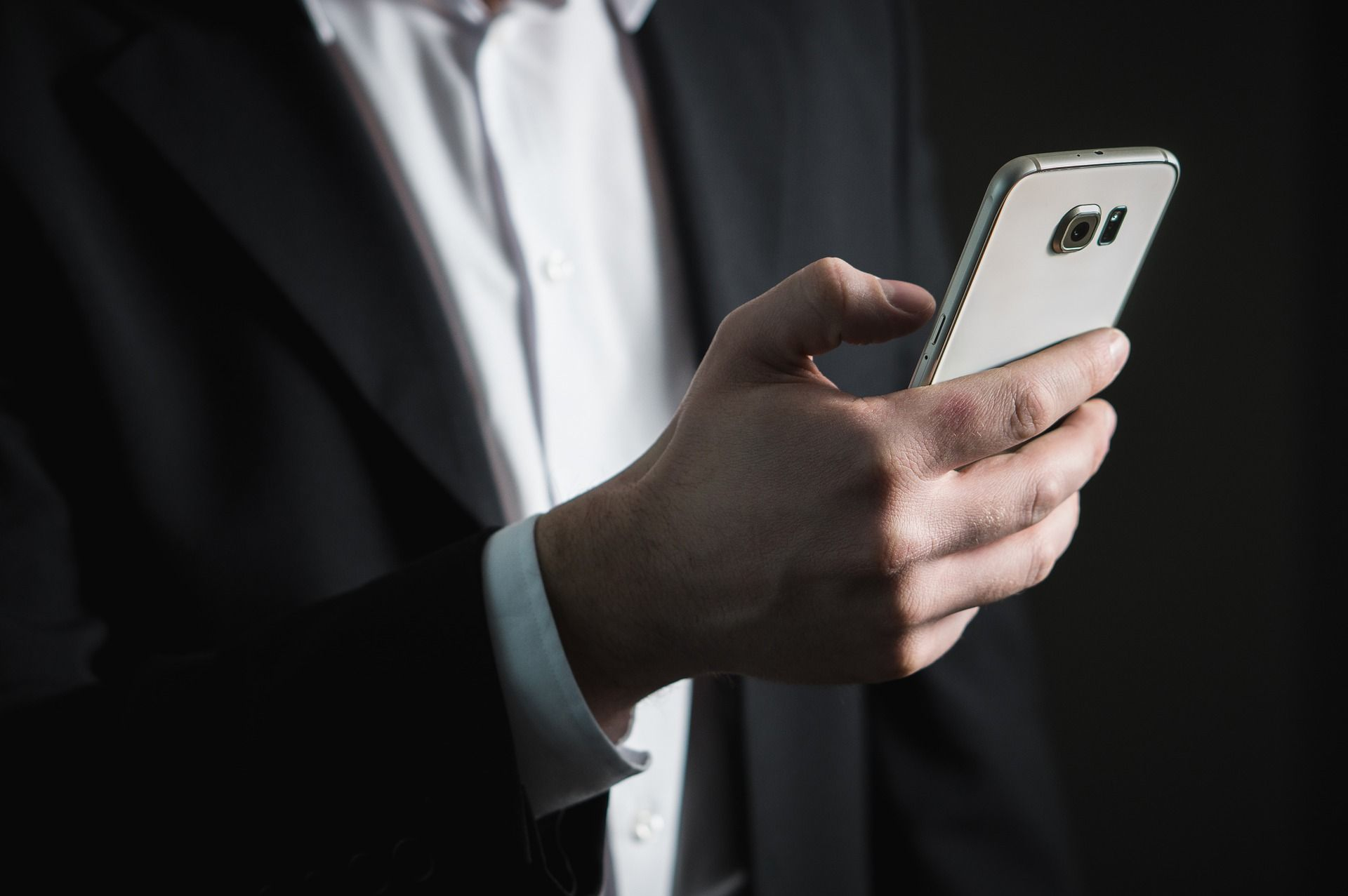 Man in a suit on his phone