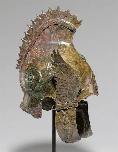 -    A Greek bronze winged helmet of Phrygian-Chalcidian type, late Classical Period, circa 4th century B.C.