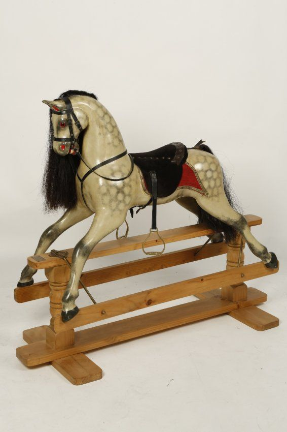 ".A BECKLES, SUFFOLK ROCKING HORSE with dapple grey finish and fitted saddle and realistic mane, the base bearing a label 'Suffolk Rocking Horses', 50"" wide"