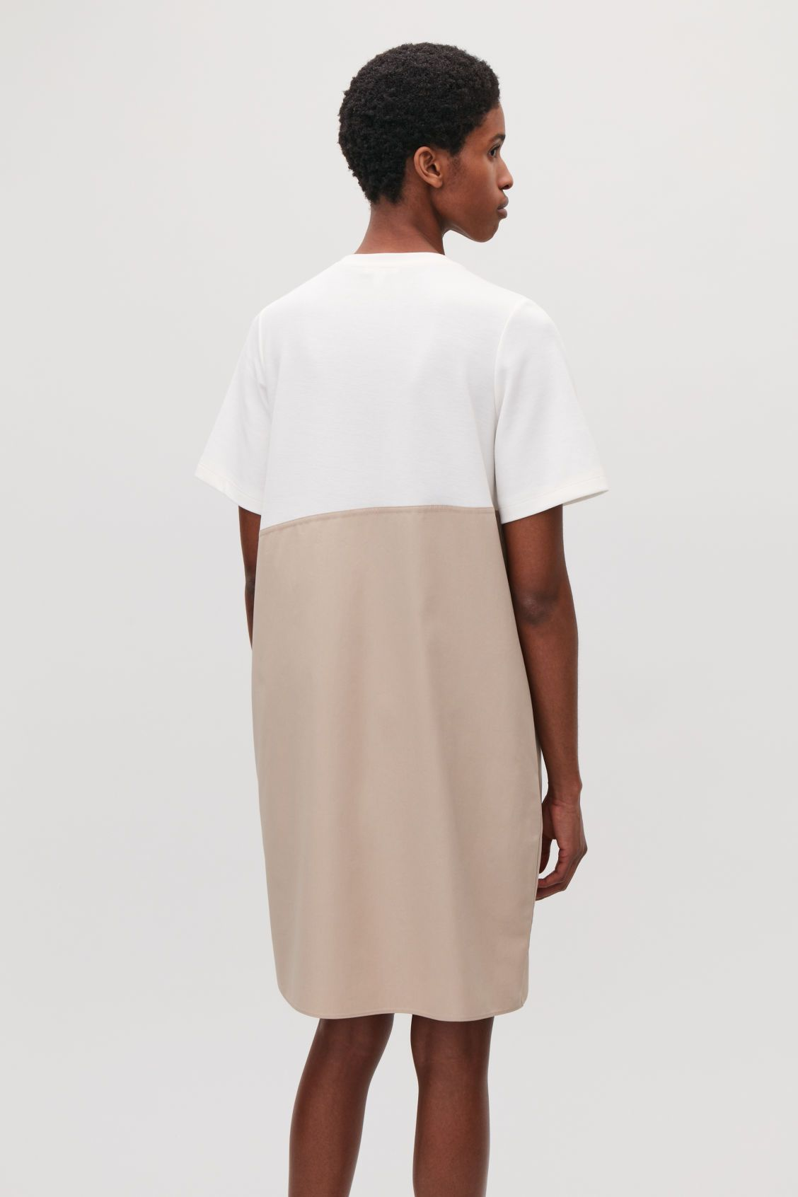 817a5c9f3888 Model side image of Cos jersey-poplin panelled dress in white Ivory Dresses,  Panel