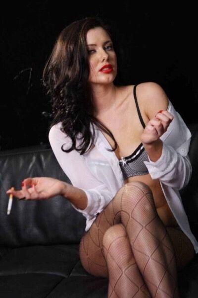 Smoking in pantyhose brunette