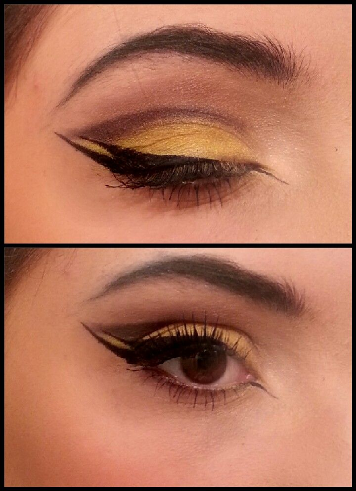 Yellow eyeshadow base with a dark grey crease, fanned out, with cat eye eyeliner! ♡