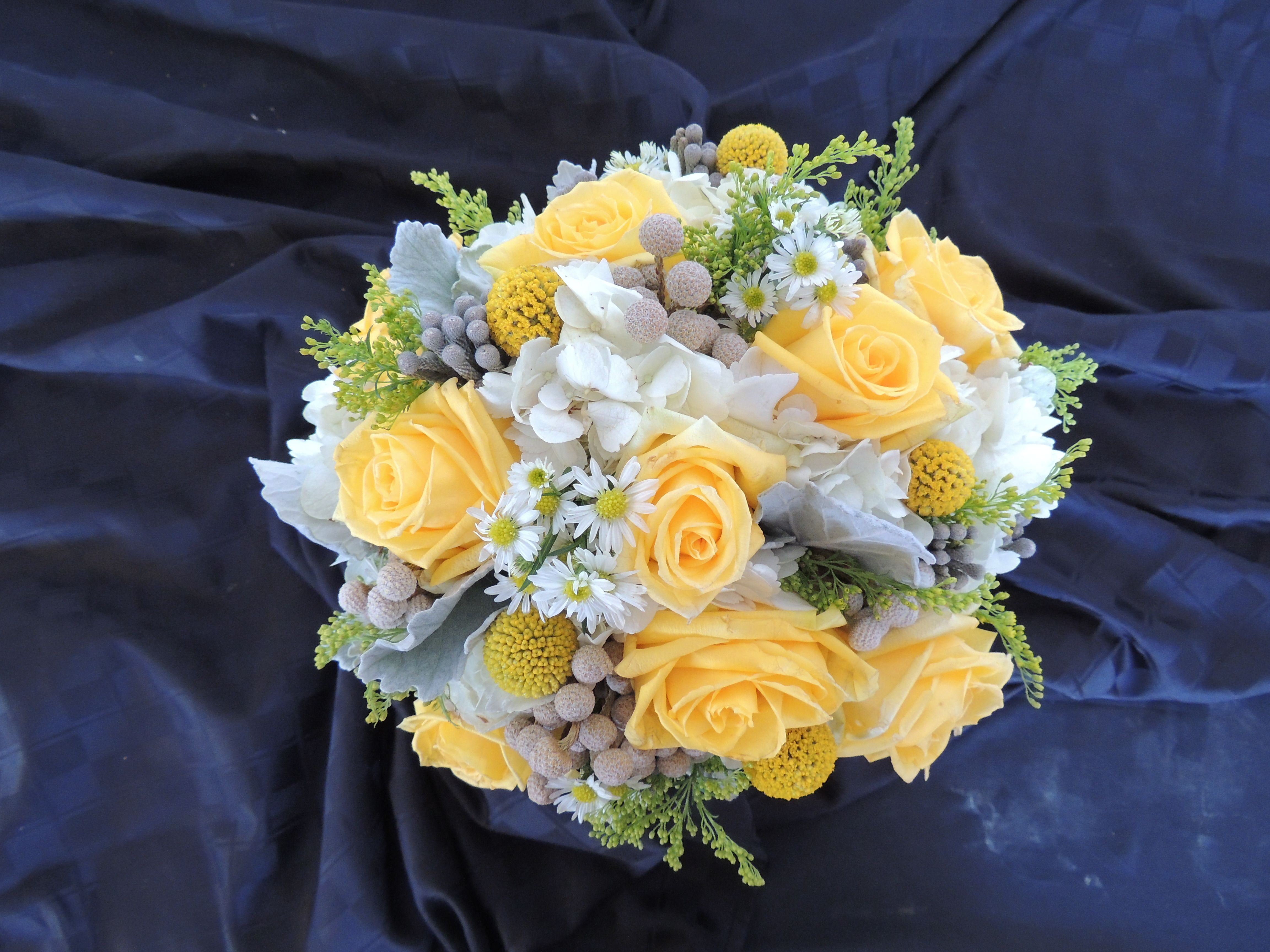Yellow rose bouquet with white and gray accent color flowers ...