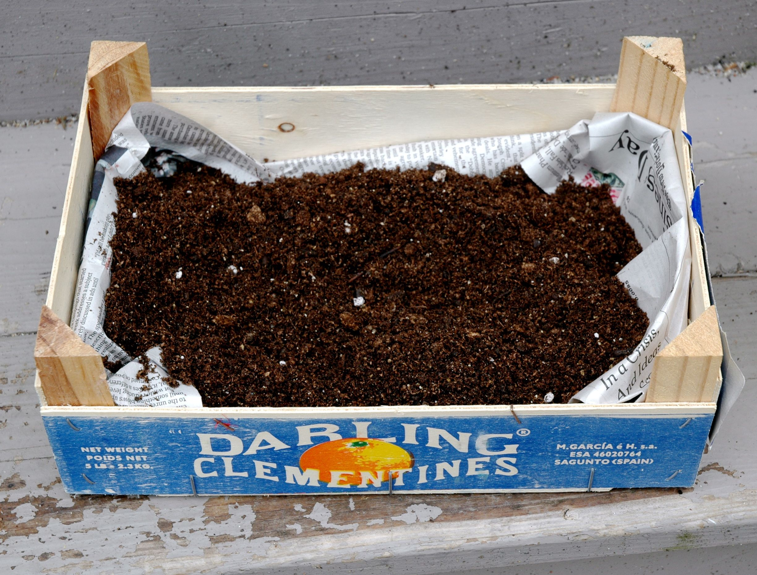 Potting Soil Garden What you need to know before starting a container gardening potting soil potting soil add potting soil to clementine box container garden workwithnaturefo