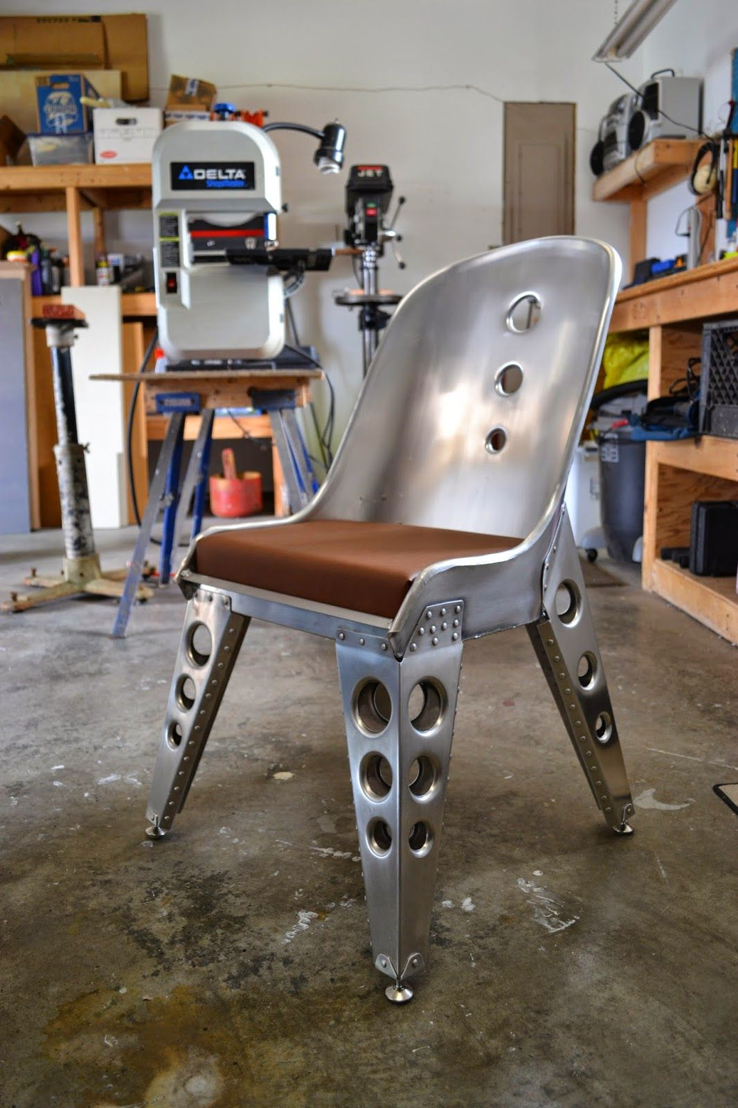 Aviation Inspired Aluminum Riveted Bomber Seat Chair Furniture - 20 unique pieces of furniture made from recycled airplane parts