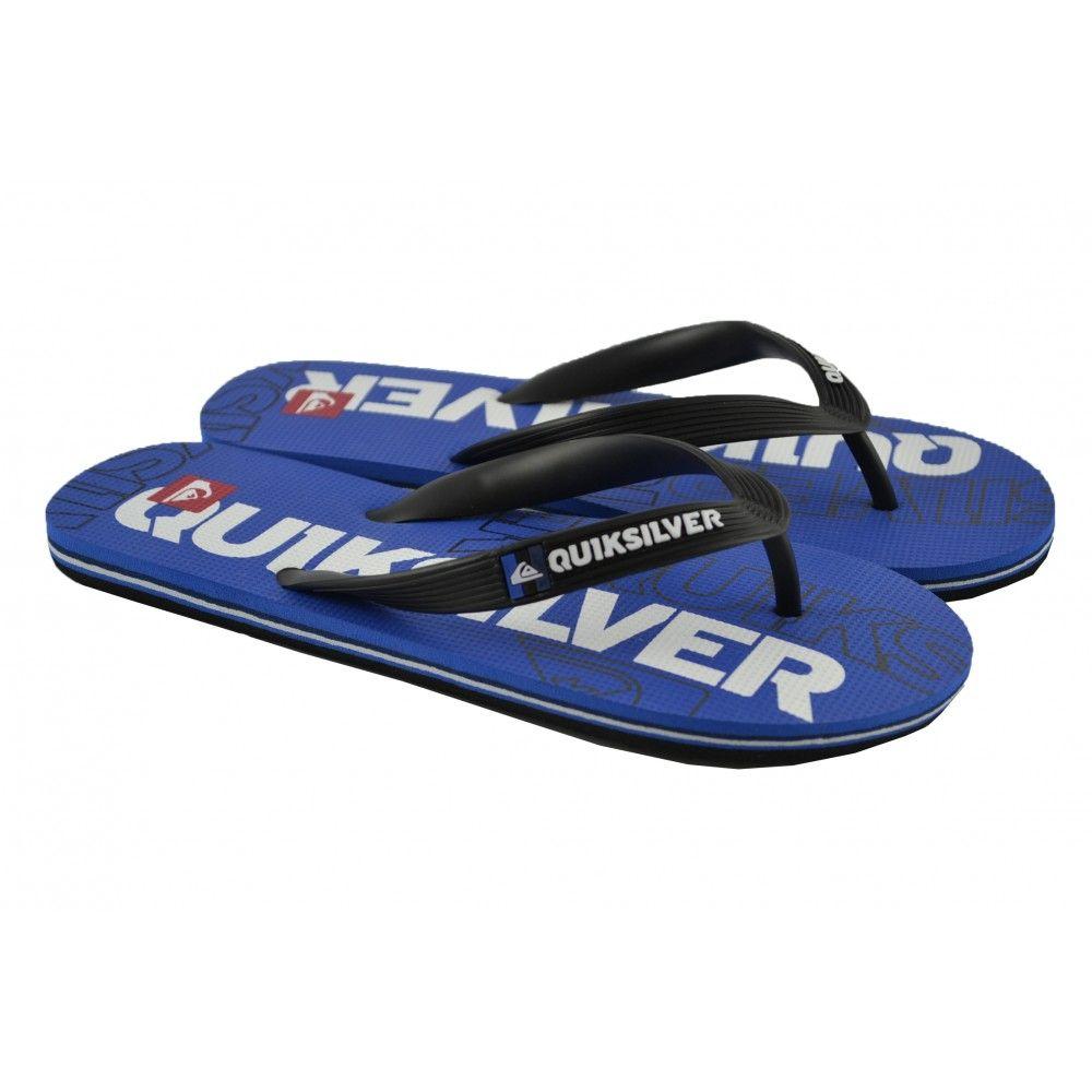 Flip flops planas de entrededo fabricadas con materiales de goma con detalles de letras en la plantilla de la marca QUIKSILVER.