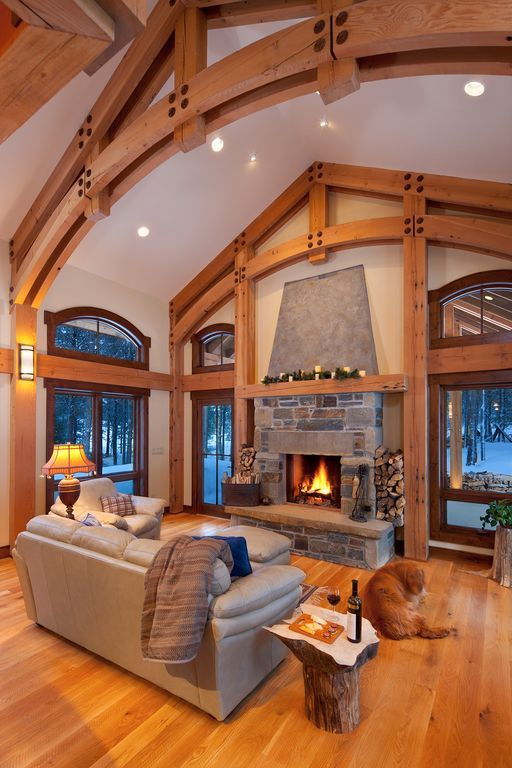 Country Great Room With Dering Hall Tree Stump Table High Ceiling Hardwood Floors French Doors Arched Window Wall Sconce
