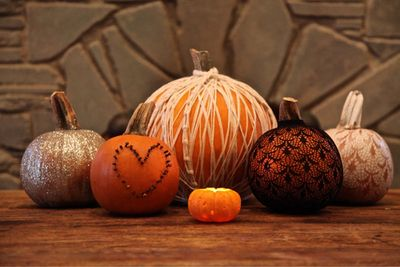 Decorate pumpkins in all types of things, spray paint them silver, gold, copper.....use burgundy mums or other colors to bring out the fall colors.