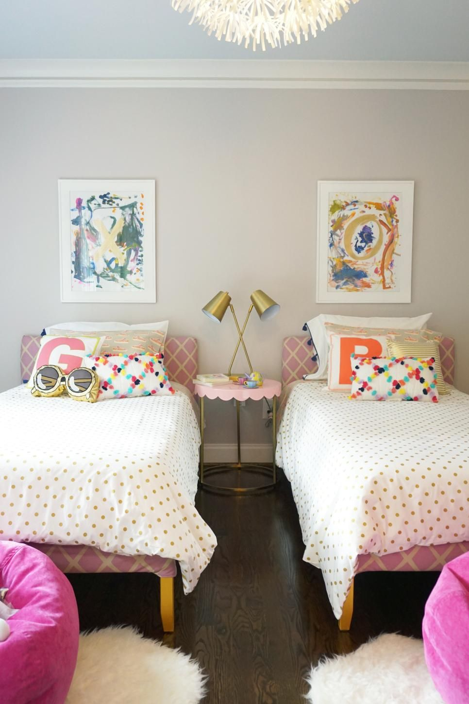 Pink And Gold Girl S Bedroom With Colorful Pillows And Paintings Shared Girls Bedroom Big Girl Bedrooms Toddler Rooms