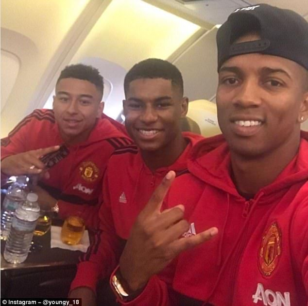 ashley young with marcus rashford centre and jesse lingard on the flight to los angeles. Black Bedroom Furniture Sets. Home Design Ideas