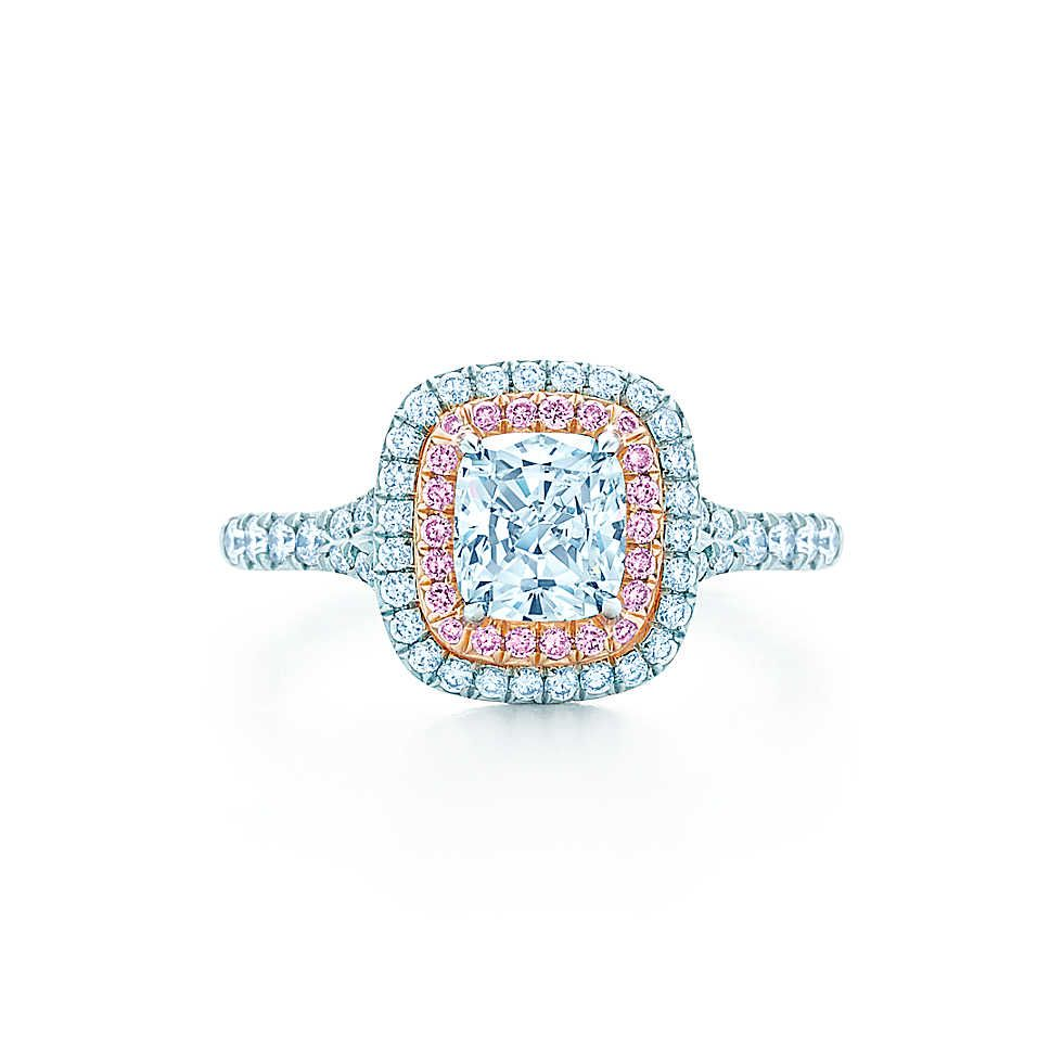 fd1ed870c84 This ring is classically elegant with a cushion-cut white diamond encircled  by a row of pink and white bead-set diamonds. A diamond band enhances the  ...
