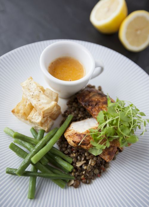 Curried monkfish sat on puy lentils served with celeriac chips and a spiced velouté.