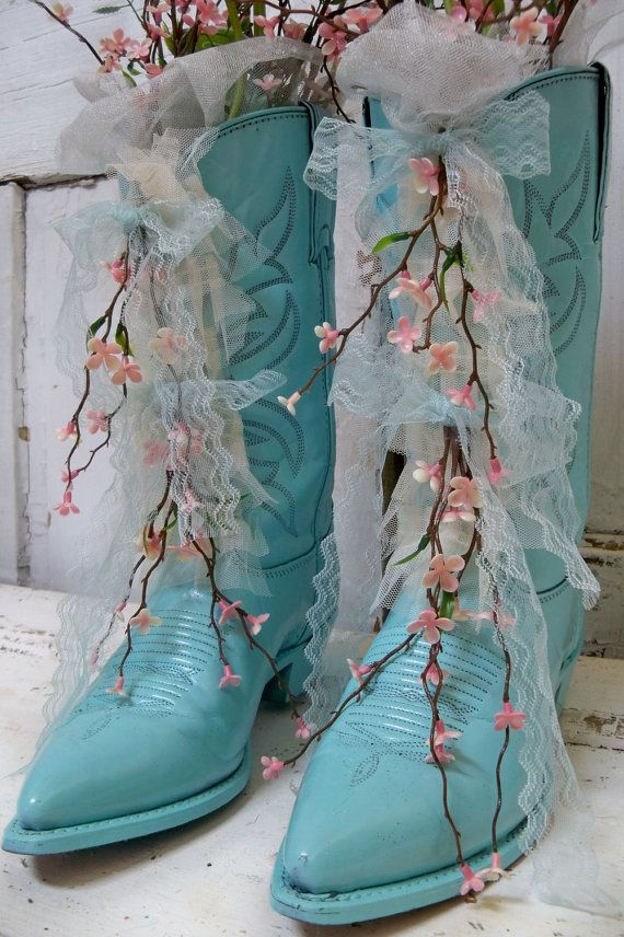 Decorative painted cowboy boots aqua blue...cute idea for old boots!  Perhaps one could make the heels glittery?