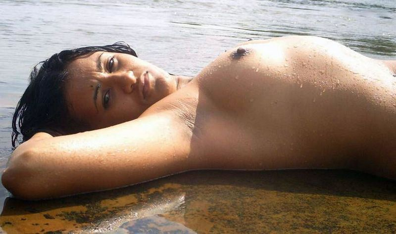 Indian women bathing nude in river