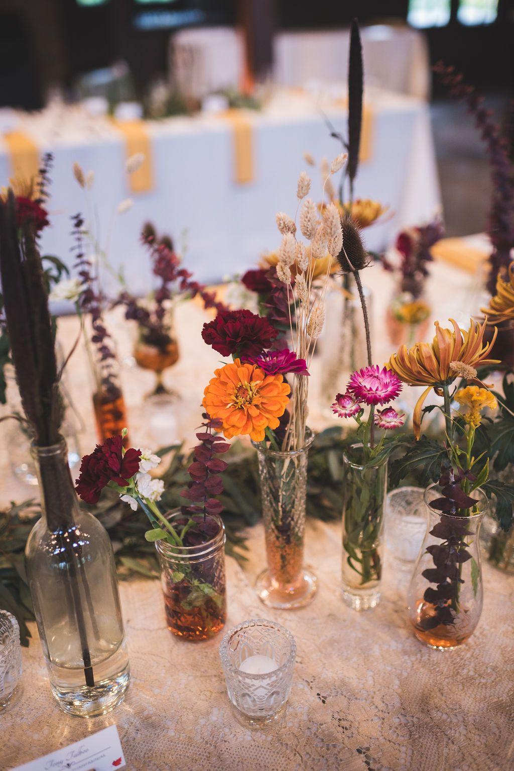 Flowers in jars flowers in jars wedding decorations