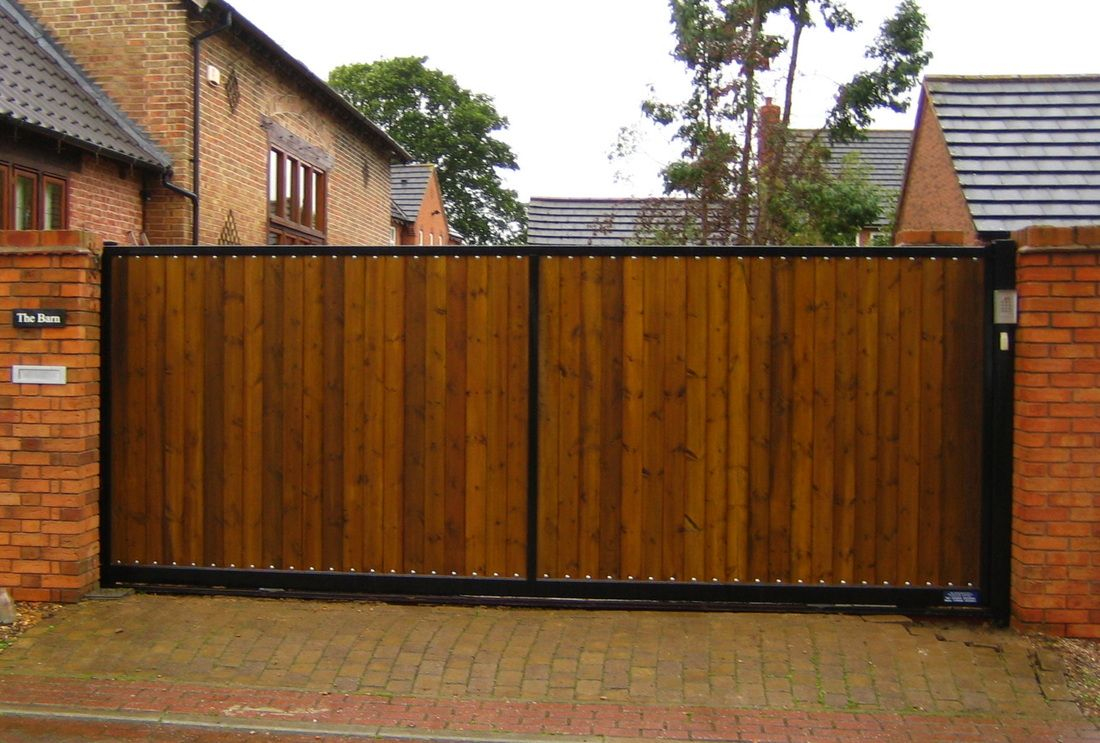Sliding driveway gates cost pinterest for Building a sliding gate for a driveway