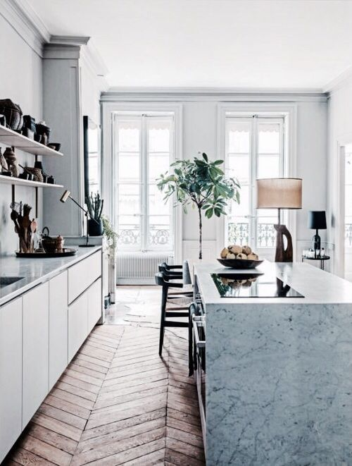 Gorgeous herringbone wood floor in kitchen with amazing marble waterfall island kitchen for Exquisite kitchen design south lyon