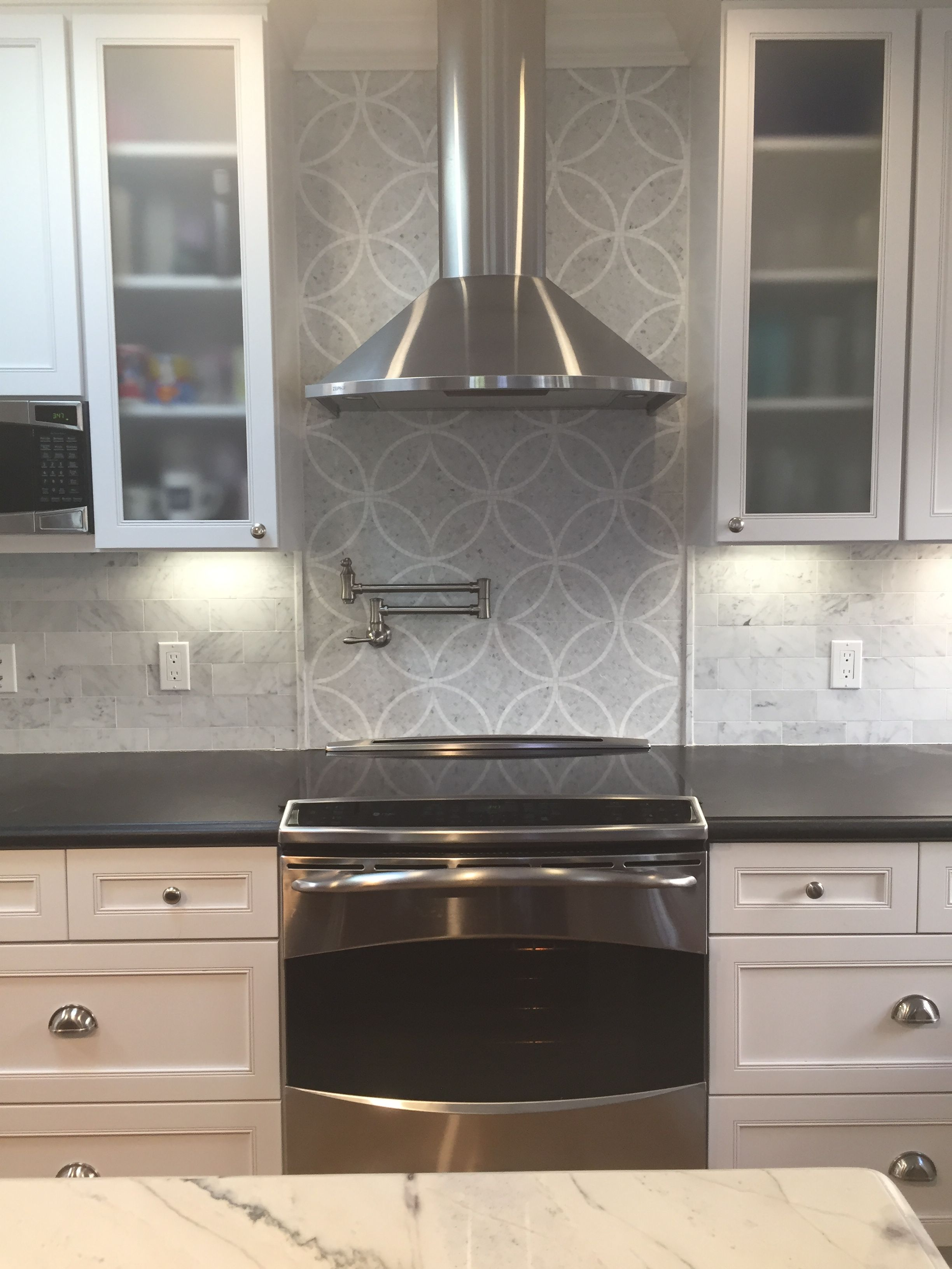 White and brown cabinets with white quarzite and gray ...