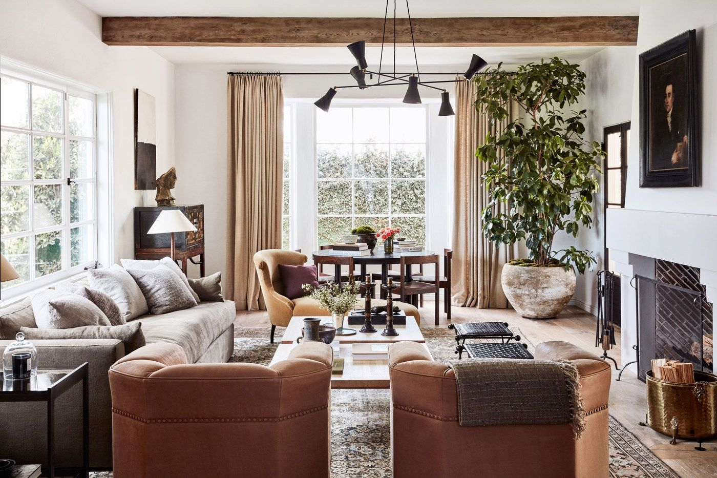 A Creative Power Couple S Spanish Colonial Retreat In L A Family Living Room Design Hygge Living Room Family Living Rooms