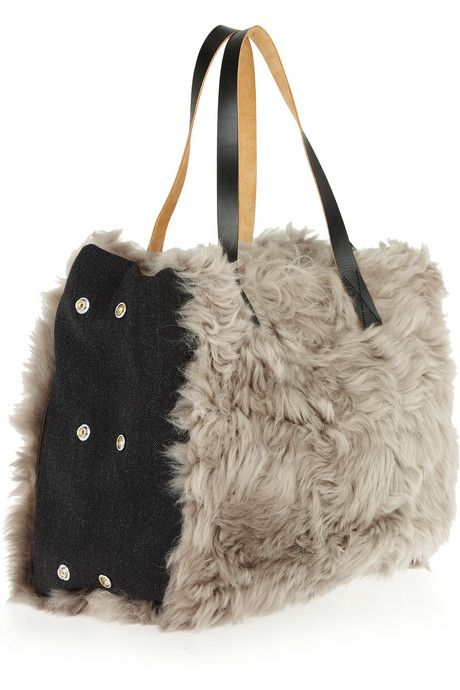 """Marni Shearling and wool tote. Give your look a textural twist with Marni's adjustable shearling and wool tote. Carry this luxe style with everything from weekend denim to a chic blouse and tailored pants. Marni tote: gray shearling and black wool, two top leather handles, side snap fastenings to adjust size, two internal pouch pockets, one internal zip-fastening pocket, fully lined. Open top. Shearling: Lamb. Weighs approximately 2lbs/ 0.9kg, Width 16"""" / 40cm, Height 19"""" / 47cm, Depth 7""""…"""