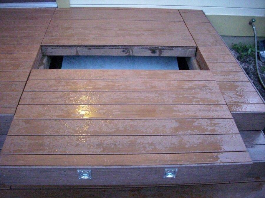 Basement access stair doors hidden under removable deck for Exterior basement access doors
