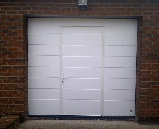 Sectional Garage Door With A Wicket Door In It Portas De Jardim Portas