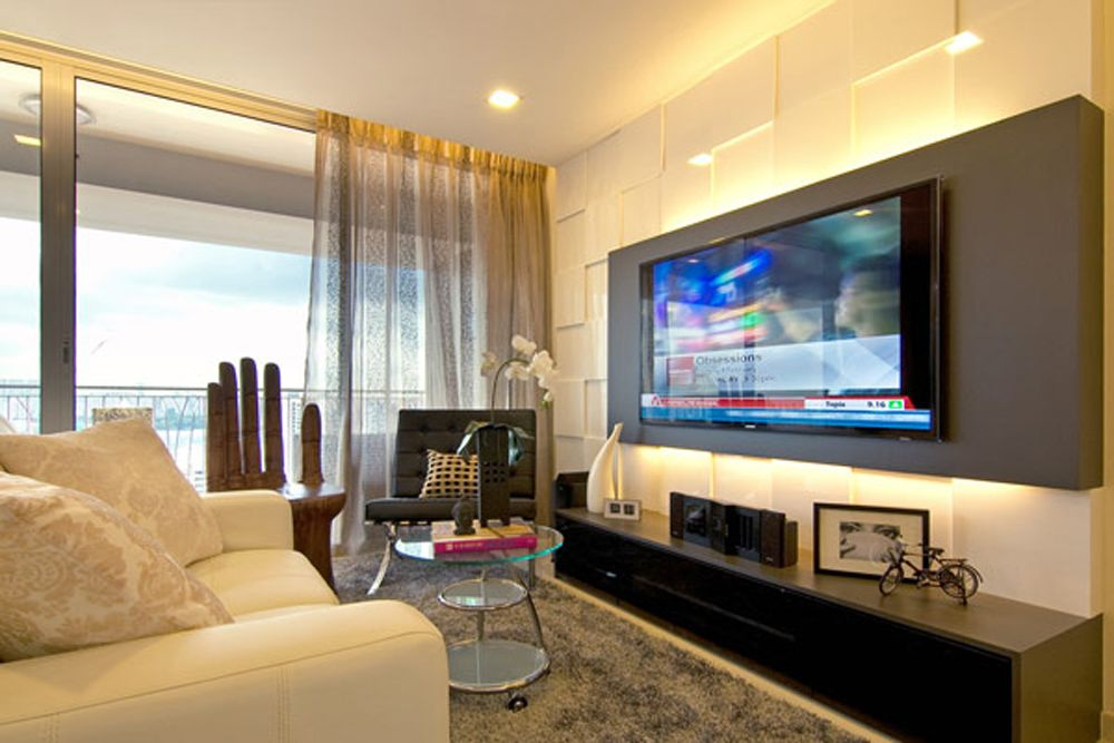 I like how the tv is mounted on the colored panel could for Modern living room apartment