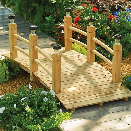 Wood Garden Bridges with Removable Plugs is part of garden Decking Wood - A decorative yet functional garden bridge will look great in a garden or backyard  Removable plugs in the wood posts allow for solar light posts