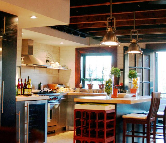 I love the details in this kitchen... the roof, the windows...lighting...Kathleen's Carriage House Kitchen Kitchen Tour