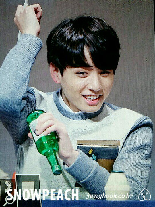 """""""Jungkook pretending to open a bottle of Soju that a fan gave him."""" <--- really kookie?! 3 days into your twenties and you already wanna turn up!"""