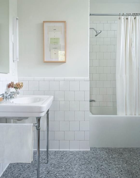 white and gray bathroom features off white paint on upper walls and white square porcelain tiles on bottom walls lined with a chrome base washstand with a - White Square Bathroom Tile