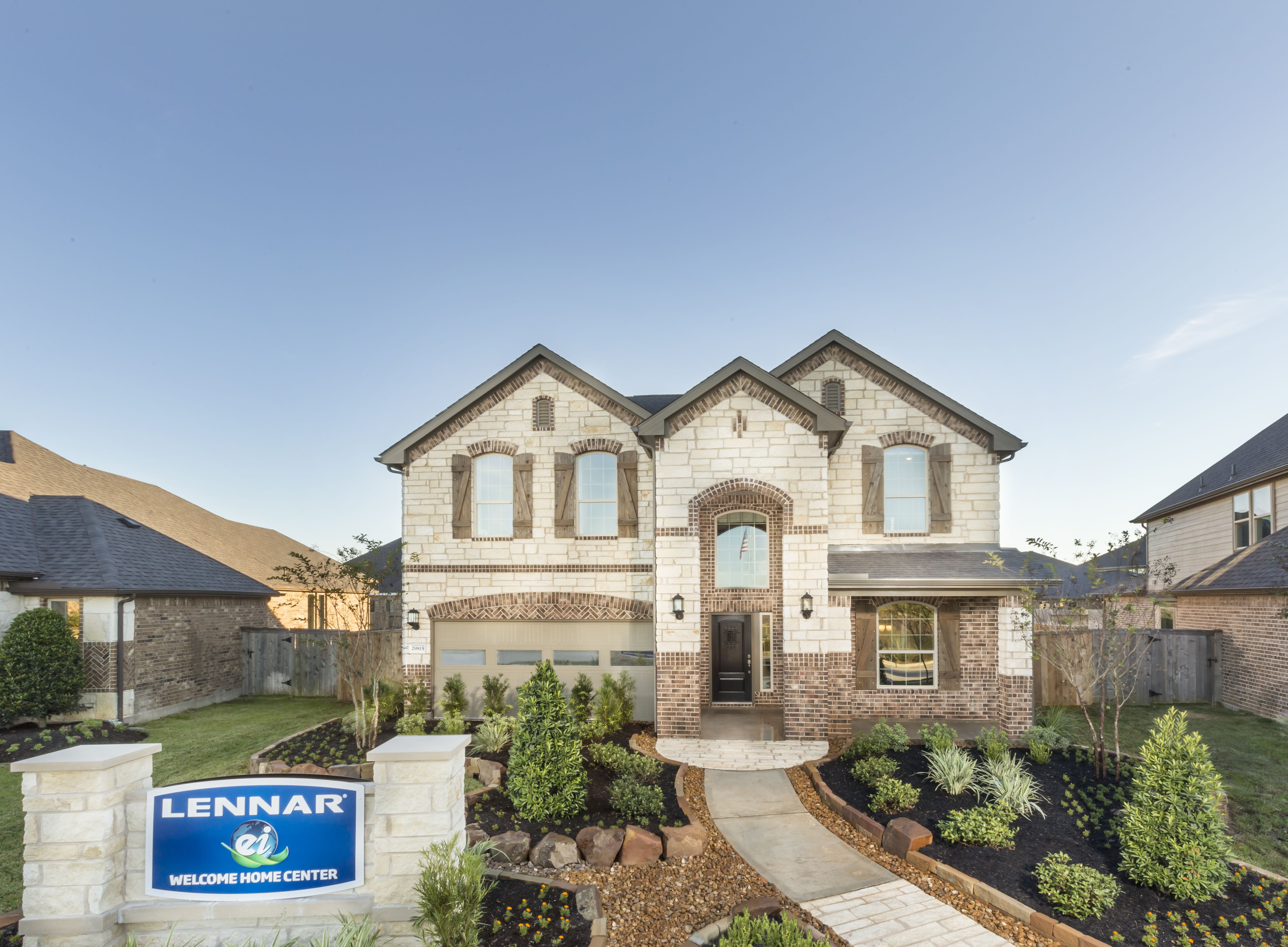 Traditional Exterior Stone Brick Design Model Home In Young Ranch Katy Tx New Home Communities Traditional Exterior Model Homes