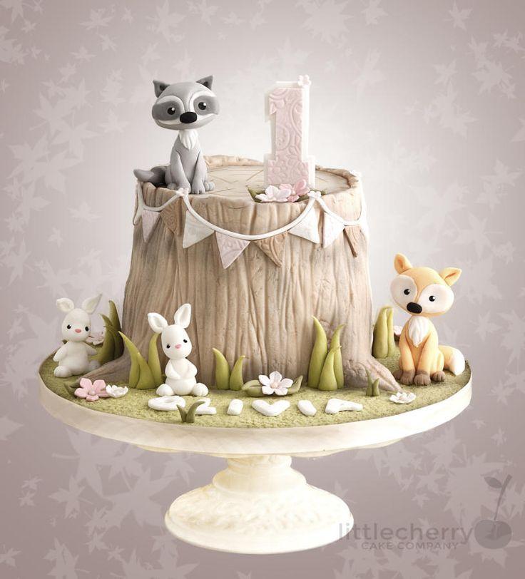 woodland animal tree stump cake with fox raccoon and