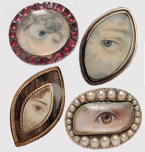 4 Georgian Mourning pins: The rubies symbolize courage and purity, and the cat's eye, platonic love.