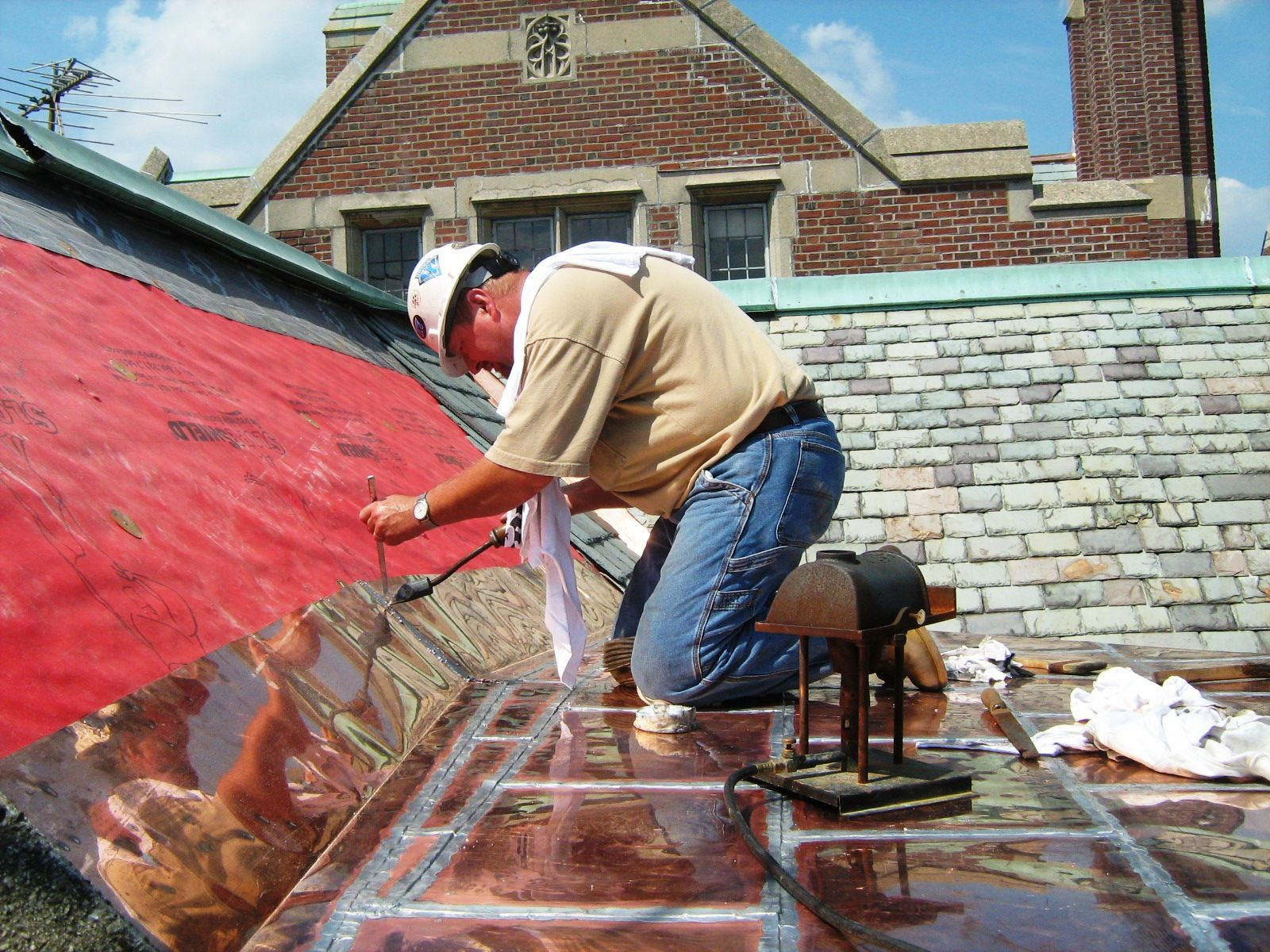 Application Of Lead Tin Solder To A Flat Seam Copper Roof Copper Roof Butterfly House Horse Farms