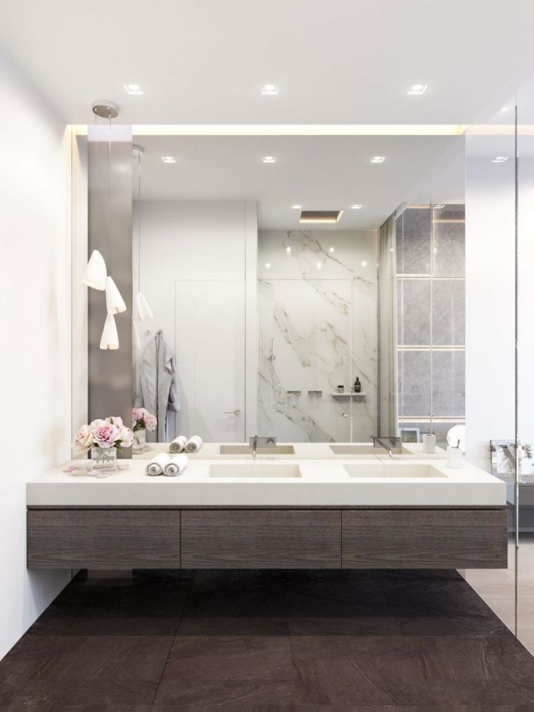 modern bathroom with dark woods, white marble and a mirror wall ...