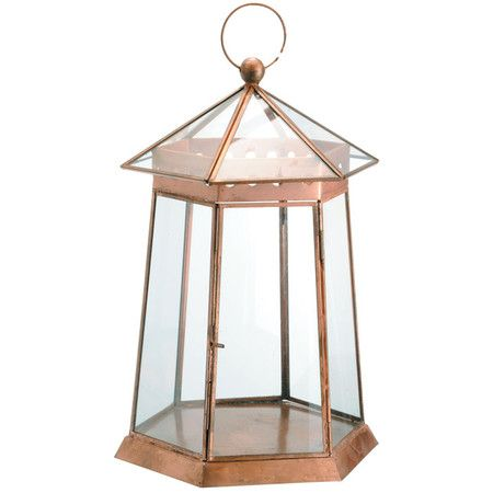 Bring a touch of charm to your home with this eye-catching accent.   Product: LanternConstruction Material: Glass...