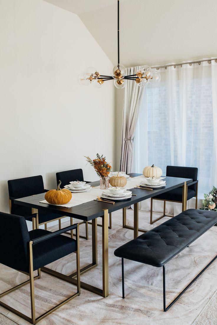 Eleganter Essbereich | goldene Details | schwarze Möbel