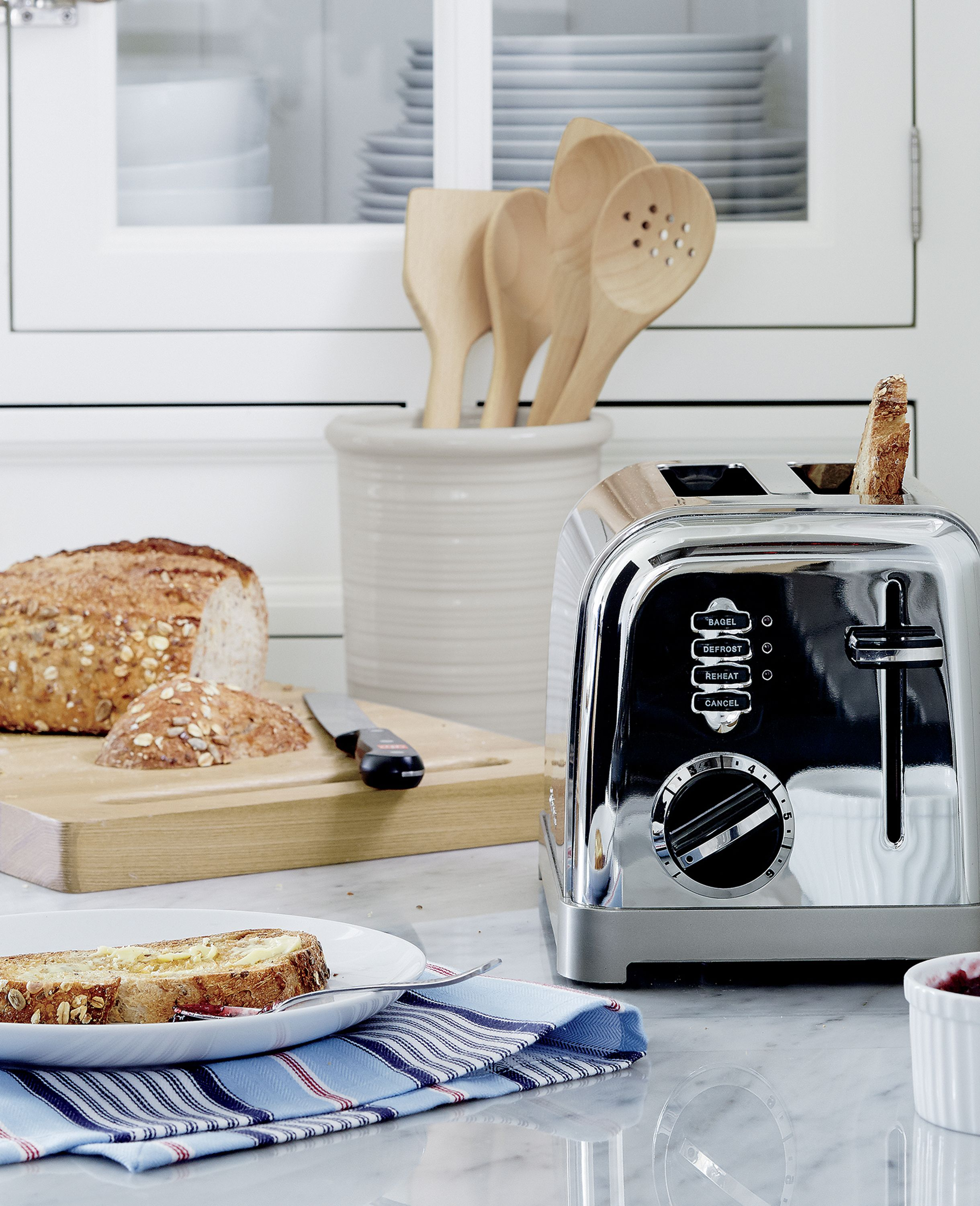 """Modern function with a retro, commercial look for your kitchen counter. Features include six-setting browning dials, 1½""""-wide slots, lift-lever for small items, slide-out crumb tray, defrost and bagel buttons with LED indicators."""