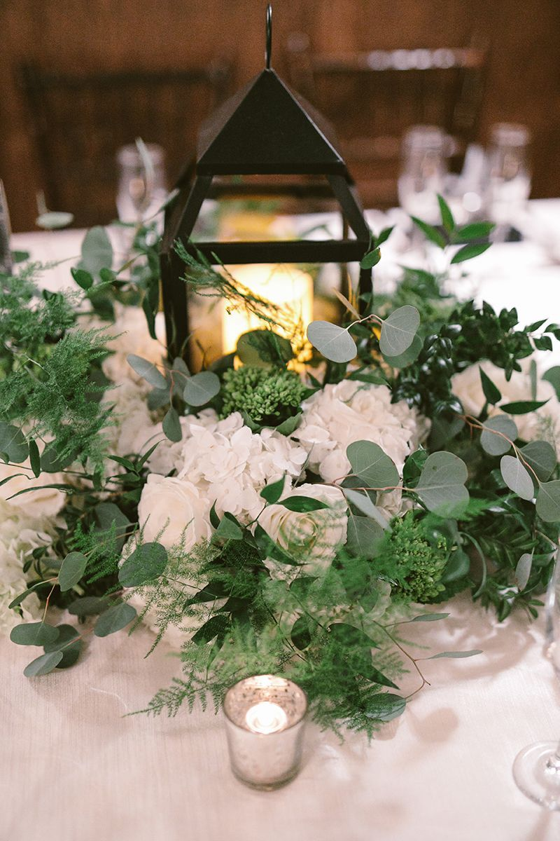 Elegant White And Green Floral Centerpieces With Black Candle Lantern Fo Wedding Table Settings Centerpieces Wedding Table Settings Flower Centerpieces Wedding