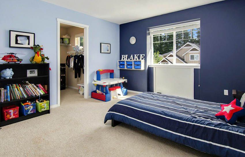 Kids Bedroom With Light Blue Walls And Dark Blue Accent Wall